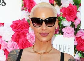 amber rose claps back at haters accusing her of being rude to sexual assault victim