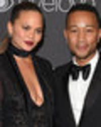 'F***ing disgusting' Chrissy Teigen and husband John Legend racially abused by paparazzi
