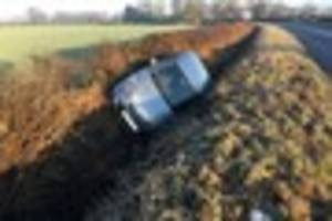 emergency services called after car lands in ditch in comberford...