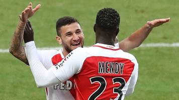 Monaco thrash Lorient to return to top in France