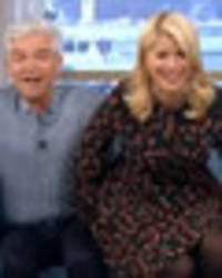 Holly Willoughby sits on Phillip Schofield's lap in shock This Morning gaffe