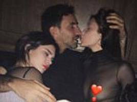 bella hadid puckers up with riccardo tisci in snap