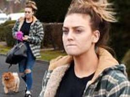 perrie edwards looks glum as she takes her dog for a walk