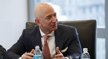 amazon chief jeff bezos backs lawsuit opposing trump immigration ban