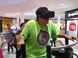 man freaks out as he tries on virtual reality headset