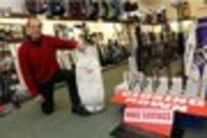 south croydon golf shop visited by a masters champion holding...