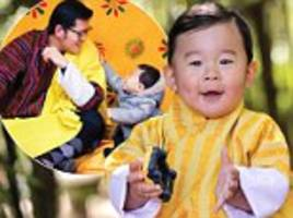 the prince of bhutan poses for his first birthday portrait