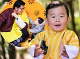 prince of bhutan poses for his first birthday portrait