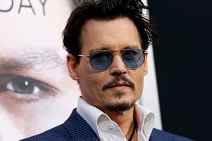 johnny depp's spending revealed in court documents: from 40 staff to yachts and private planes - and millions on firing friend's ashes out of a cannon