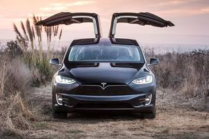 tesla model x review – electric car scores on the doors