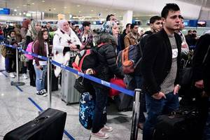 state dept: fewer than 60,000 visas canceled by immigration executive order