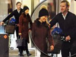 pippa middleton's fiance pushes her vintage bike for her