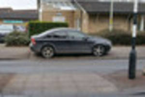 woman thunderstruck by phenomenally bad parking outside doctors'...