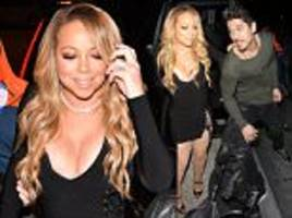 mariah carey leaves little to the imagination in mini
