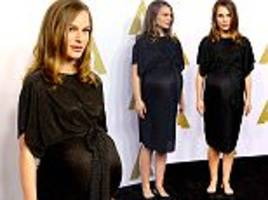 pregnant natalie portman shows off blossoming baby bump