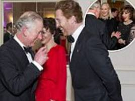 prince charles jokes with damian lewis at charity gala