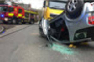 watch dramatic moment car overturns in ilkeston