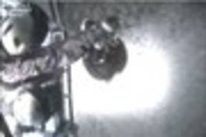 Dramatic footage shows coastguard helicopter crew winching two...