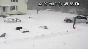 car veers off road in us blizzard