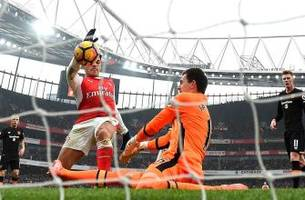 sanchez double sees arsenal beat hull amid controversy