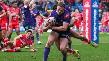 wigan start title defence with win at salford