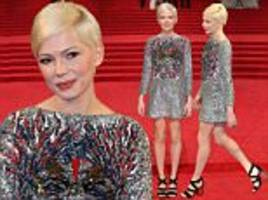 michelle williams stuns in silver on the bafta red carpet