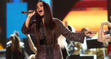 demi lovato wins the grammys with sexy see-through dress and an amazing bee gees tribute