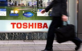 Toshiba's chairman resigns as the company delays reporting its earnings