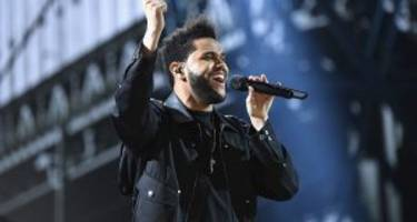 The Weeknd Celebrates His Space-Themed Grammy Performance While Justin Bieber Throws Shade at Him