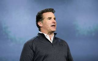 wall street analyst downgrades under armour stock on ceo's praise of trump