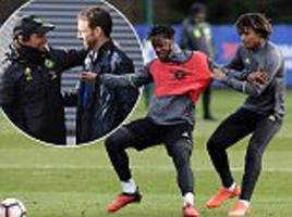 conte welcomes gareth southgate to chelsea training