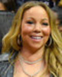 mariah carey's has mother of all nip slips as boobs escape tiny top