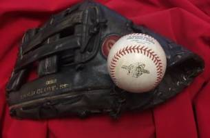 see darin erstad's glove and ball from last out of 2002 world series