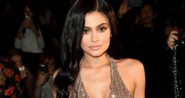 kylie jenner shows off the famous kardashian 'kurves' in poolside instagram post