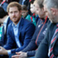 Prince Harry delights rugby supporters as he joins fans to watch the England team train