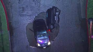 Two cars fall into Los Angeles sinkhole