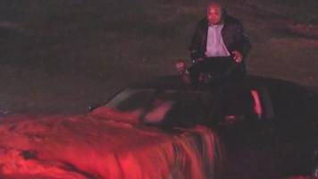 man saved from nearly submerged car in la