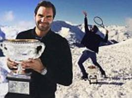 Roger Federer shows off Australian Open trophy