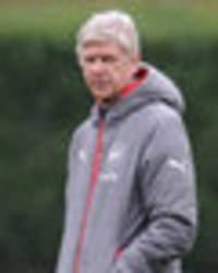 Snapped: Under-pressure Arsene Wenger looks stressed in Arsenal training ahead of Sutton