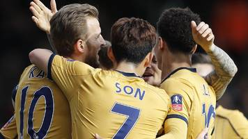 kane hat-trick sees spurs into last eight