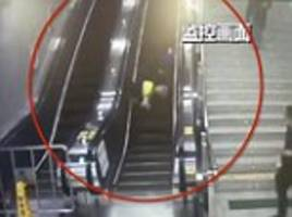 Nail-biting moment old woman tumbles down an escalator