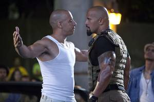 vin diesel and dwayne johnson are caught in a pop music cold war