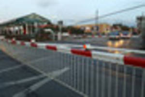 gridlocked traffic as level crossing barrier gets stuck in...