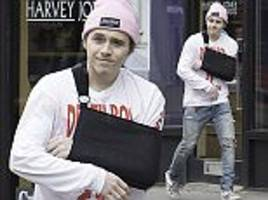 brooklyn beckham manages a smile as he steps out in london
