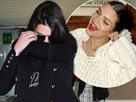 Kendall Jenner covers up at London Heathrow