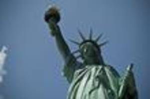 'Refugees Welcome' Banner Unfurled Across Statue Of Liberty's Pedestal
