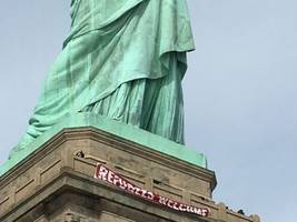 Statue Of Liberty's Guerrilla 'Refugees Welcome' Banner Removed By Park Officials