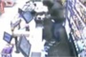 Watch two men carry out knife-point robbery at store