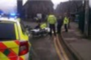 Motorcyclist in hospital following crash between car and bike