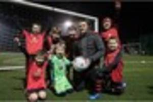 stoke old boy andy wilkinson returns to his roots to help kids...